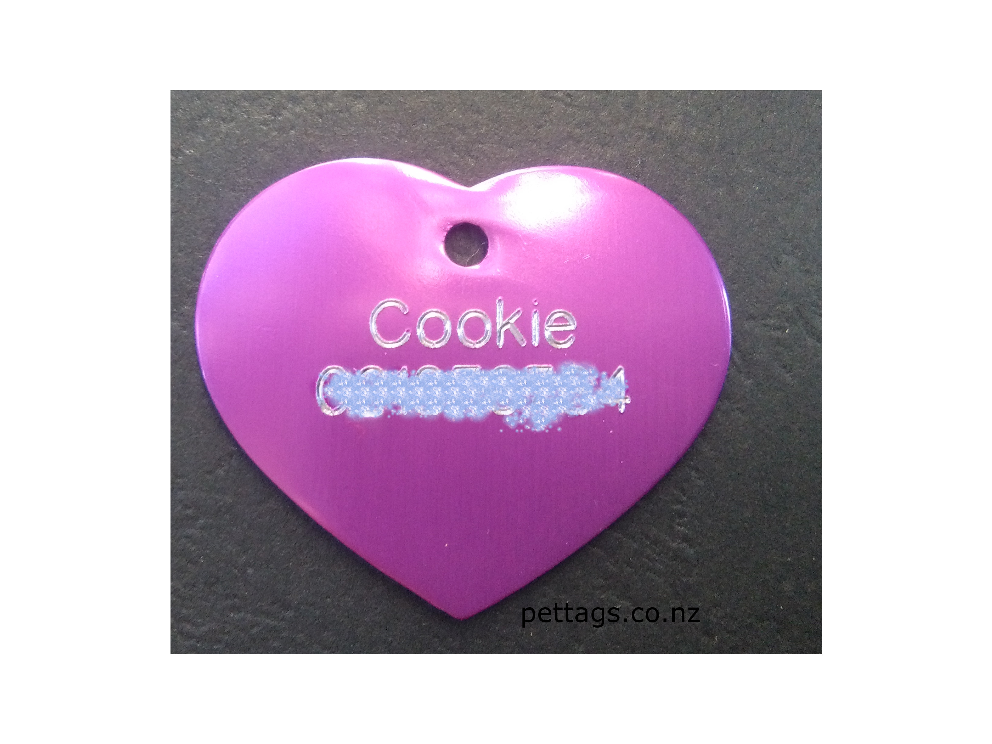 engraved pet tag in heart shape